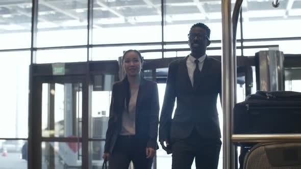 Business Representatives Walking Through Hotel Hall