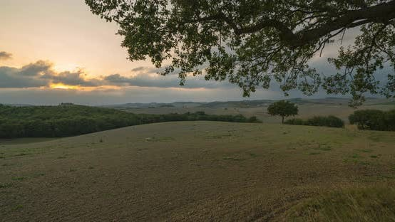 Timelapse View of a Rural Landscape During Sunset in Tuscany. Rural Farm, Cypress Trees, Green