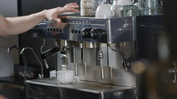 Thumbnail for Tattooed Male Barista Making Americano on Coffee Machine