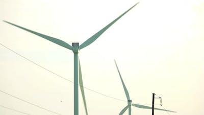 Working Wind Turbine Against Clear Sky