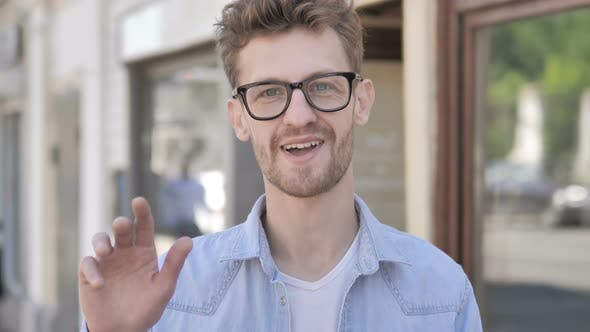 Thumbnail for Online Video Chat by Casual Young Man Standing Outdoor
