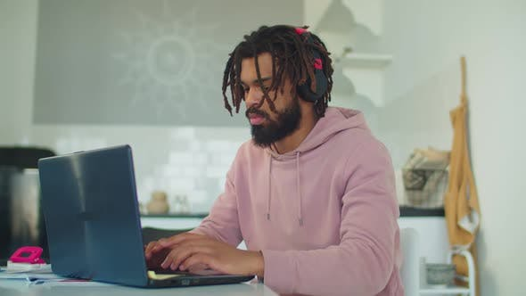 African American Student E-learning with Laptop