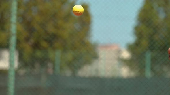Thumbnail for Close up of a tennis racket hitting the ball, Ultra Slow Motion