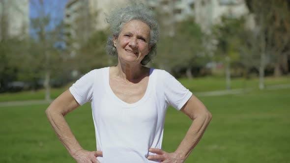 Thumbnail for Smiling Senior Woman Posing on Green Meadow