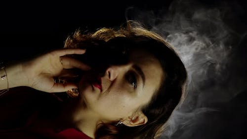 Thoughtful Woman with Steam Rising Up Above Head on Black