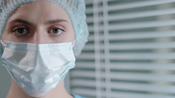 Thumbnail for Portrait of Female Doctor in Protective Face Mask and Uniform at Work