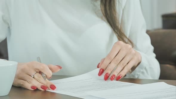 Cover Image for Woman Hand Putting Signature on Contract