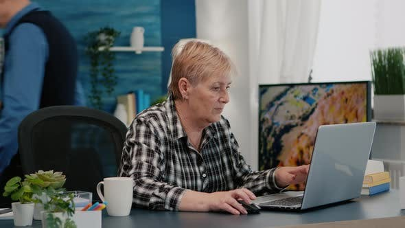 Overworked Senior Woman Working From Home at Laptop