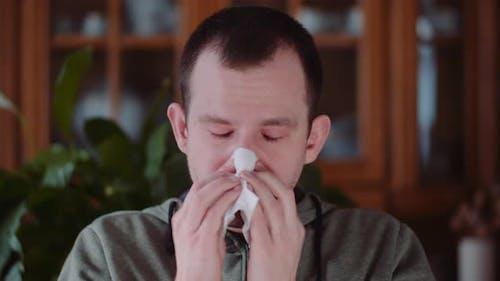 Young Weak Man Sneezing Having Temperature. Cough.