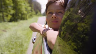 Video of boy enjoying the road on the road breeze.   Shot with RED helium camera in 8K.
