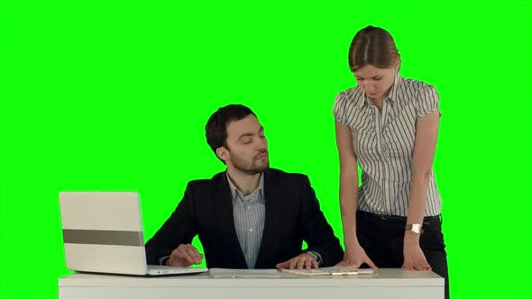 Thumbnail for Business People Having Meeting Around Table with Laptop on Laptop on a Green Screen, Chroma Key