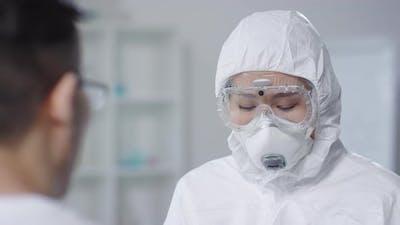 Doctor in Hazmat Suit Examining Contagious Patient