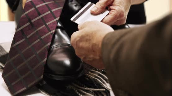 Thumbnail for Closeup of a mature male Caucasian purchasing clothes
