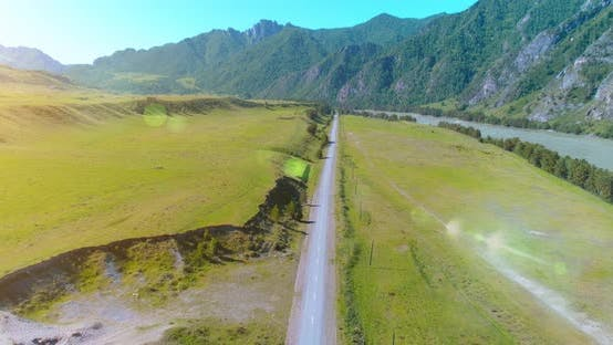 Thumbnail for Aerial Rural Mountain Road and Meadow at Sunny Summer Morning, Asphalt Highway and River