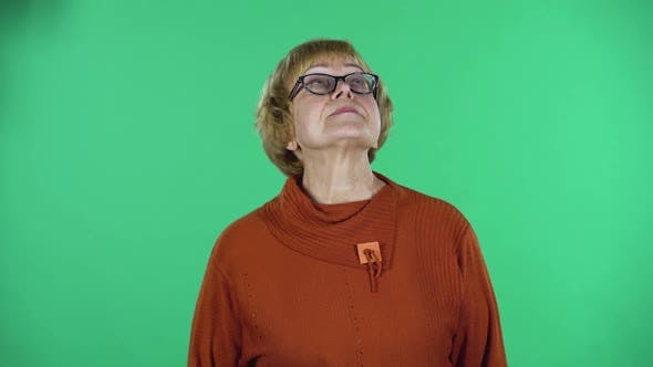 Thumbnail for Portrait of Senior Woman Is Waiting Isolated Over Green Background