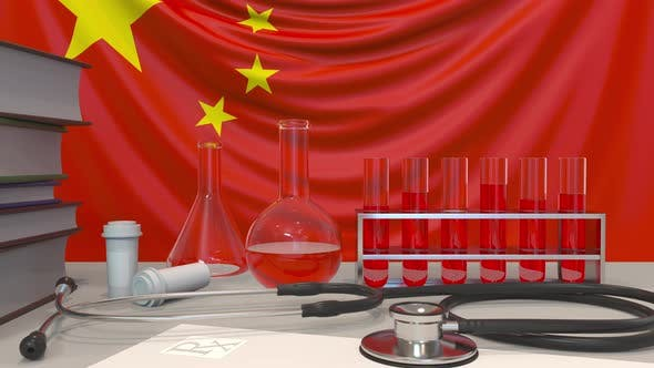 Clinic Laboratory Equipment on Chinese Flag Background