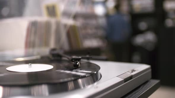 Thumbnail for Vinyl Record Spinning on Turntable in Music Store