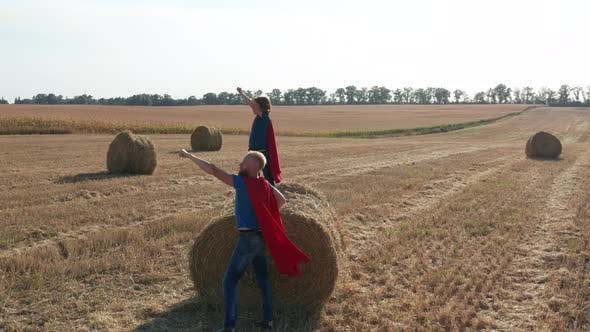 Thumbnail for Aerial Shot of Dad with Son in Superhero Costumes