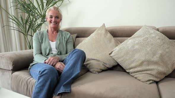 Mature woman relaxing on sofa