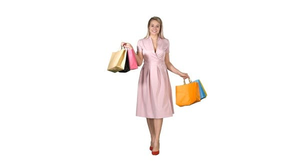 Thumbnail for Young blonde girl in pink dress showing to camera shopping