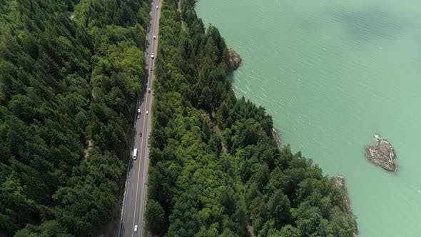 Thumbnail for Beautiful Ocean Highway Aerial Of People On Roadtrip By Green Forest And Turquoise Water