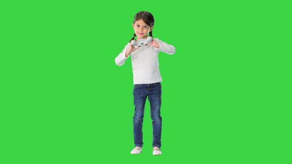 Thumbnail for Excited Little Girl Play Videogame Holding Joystick in Her Hands on a Green Screen, Chroma Key