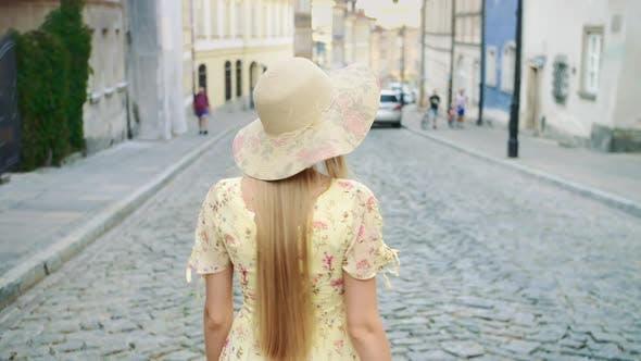 Smiling Woman Walking on Street