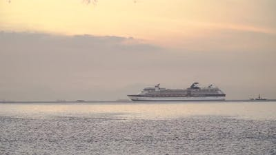 Cruise Ship in the Sea at Sunset