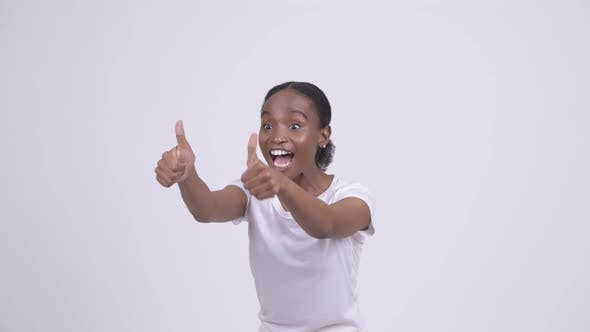 Thumbnail for Happy Young Beautiful African Woman Giving Thumbs Up and Looking Excited