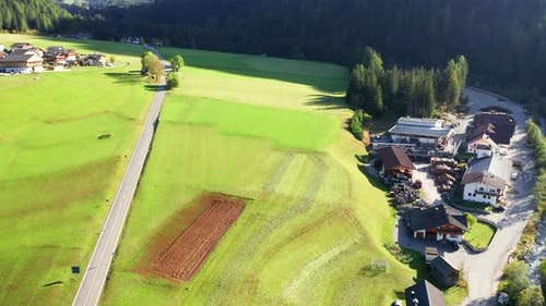 Aerial footage of A beautiful Alps Green Valley during Fall Season