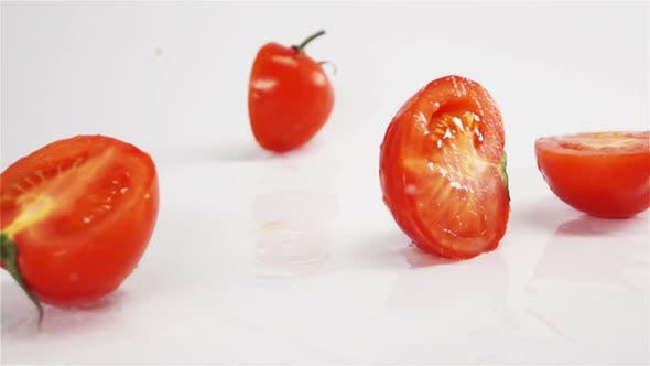 Thumbnail for Few Sliced Tomatoes Breaking on White Surface
