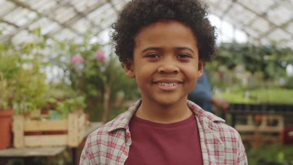Portrait of Happy Afro-American Boy in Greenhouse