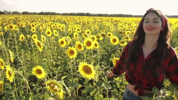 Thumbnail for Sensual Brunette Girl Walking in Sunflower Field