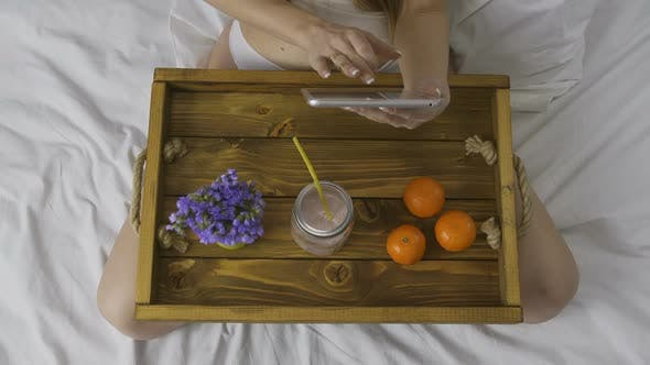 Thumbnail for Top View of Woman with Touchpad and Smoothie