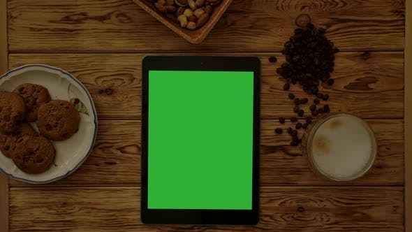 Thumbnail for Tablet Near Biscuits and Cappuccino