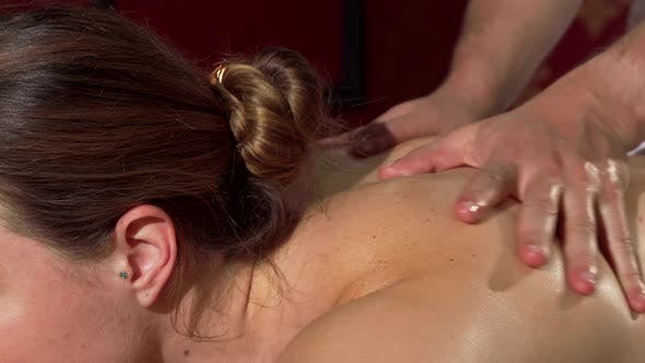 Thumbnail for Professional Masseur Working at Spa Center Massaging Back of a Beautiful Woman
