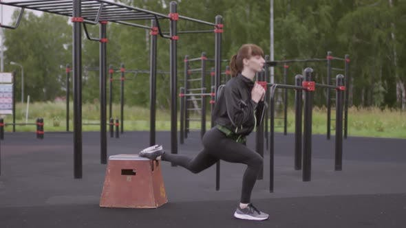 Woman Doing Bulgarian Split Squat Exercise at Outdoor Fitness Court