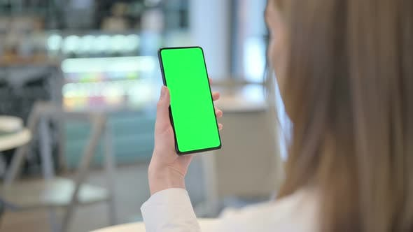 Thumbnail for Woman Watching Video on Smartphone with Chroma Screen