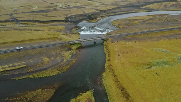 Aerial Drone Footage of Car Drives on the Bridge Over the River in Iceland