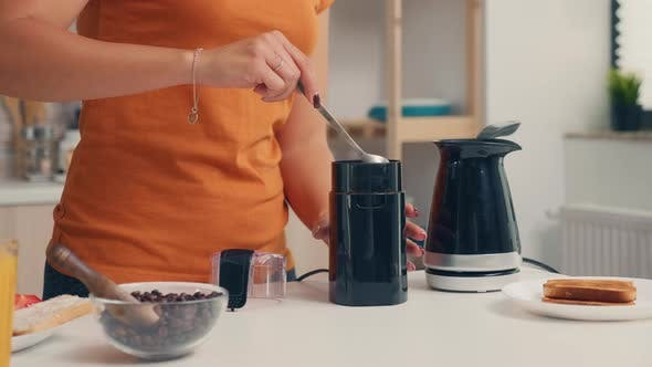 Thumbnail for Putting Coffee in Electric Pot