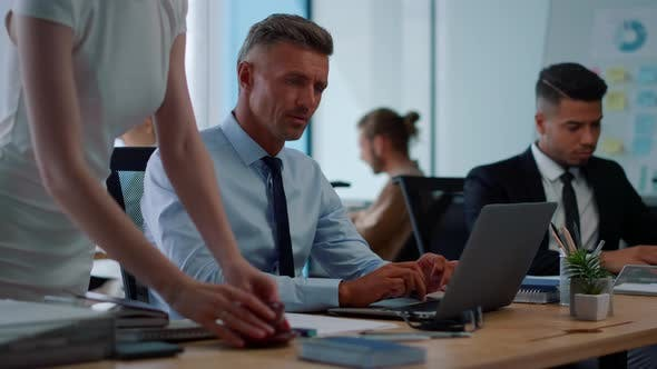 Thumbnail for Focused Businessman Typing on Laptop. Male Employee Talking with Colleague