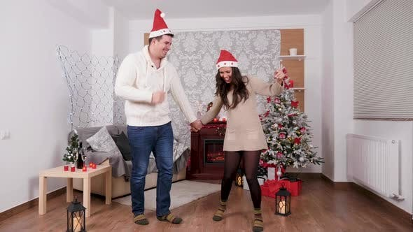 Thumbnail for Happy Couple Celebrating Christmas Dancing in the Living Room