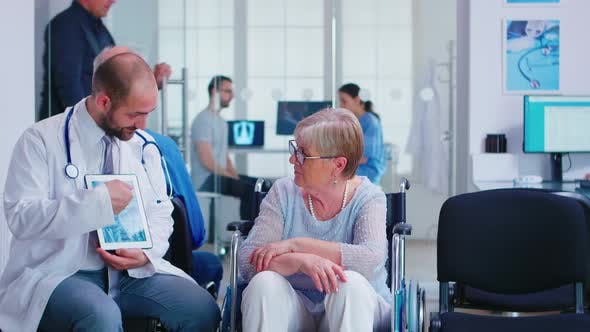 Cover Image for Doctor Explaining Diagnosis To Elderly Woman in Wheelchair