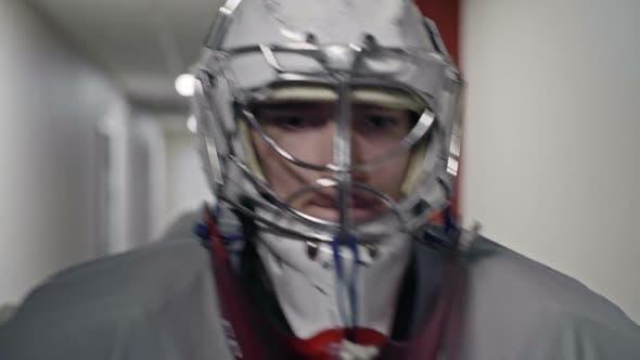 Thumbnail for Hockey Players Walking along Corridor