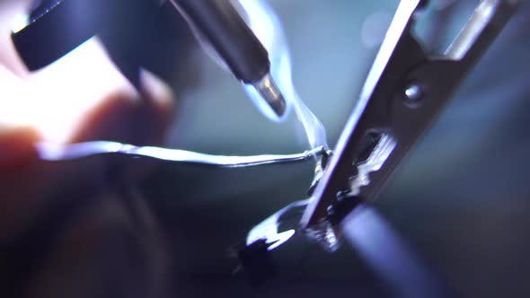 Thumbnail for Working with a Soldering Iron at His Working Place