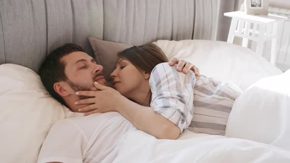 Thumbnail for Couple Waking Up and Kissing in Bed