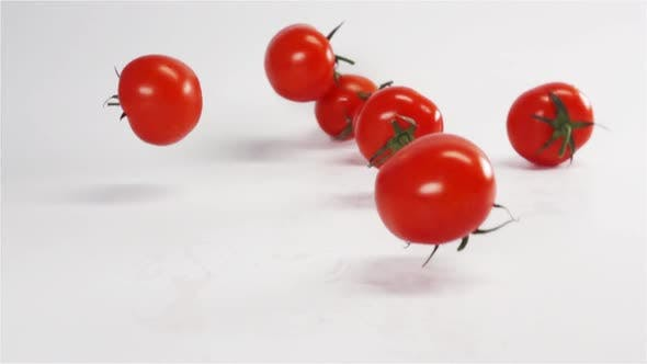 Thumbnail for Many Fresh Tomatoes Falling on White Background.