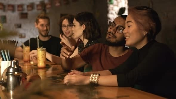 Thumbnail for Multiethnic Young People Sitting at Bar