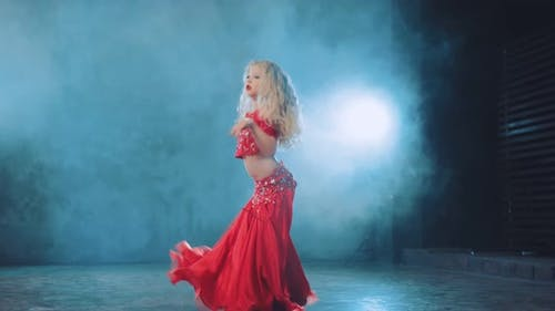 Young Blonde Dances Oriental Dance in a Beautiful Suit with Stones