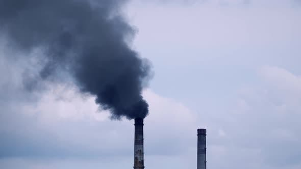Factory pipe polluting air. Plant emits smoke and smog from the pipes